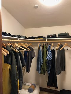Walk-in closet also has shelves (4 levels) on other side with extra towels.