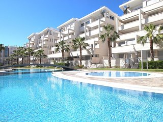 Cozy apartment a short walk away (358 m) from the 'Playa Nova' in Dénia with Par