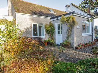 ROSE COTTAGE, semi-detached, single-storey, woodburner, shared garden, in