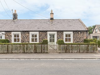 RISING SUN, end-terraced cottage with woodburner, garden, amenities on