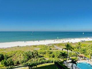 Inviting beachfront condo w/ wraparound balcony, heated pools & hot tub