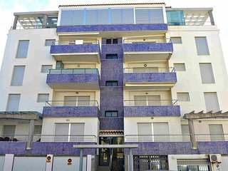 Spacious apartment a short walk away (126 m) from the 'Playa de L'Aigua Blanca'