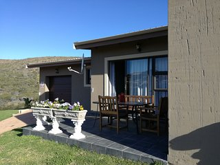 Townhouse S/C in peaceful setting in Mossel Bay with views of mountains and sea