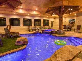 Mountain Lodge with an indoor pool, 6 bedrooms, 7 1/2 baths. Sleeps 24.