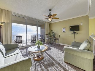 Gulf Front condo featuring a shared pool w/ a hot tub, steps to beach!