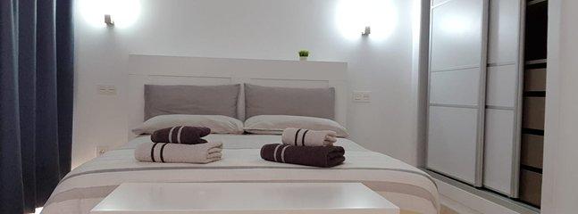 Dormitorio principal con AC