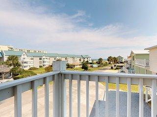 NEW LISTING! Gulf view duplex w/balcony, beach access & shared pools/hot tub/gym