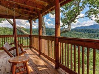 Spacious cabin w/ private hot tub, large wraparound deck, & mountain views