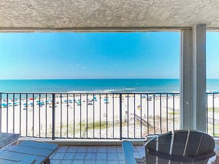 Stunning beachfront condo w/shared pool, balcony w/incredible views