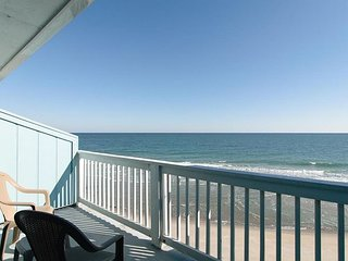 Top floor oceanfront condo with expansive coastline views