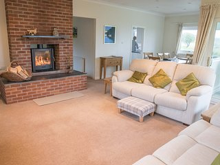 Living room with two three-seater sofas and a double-sided wood-burning stove