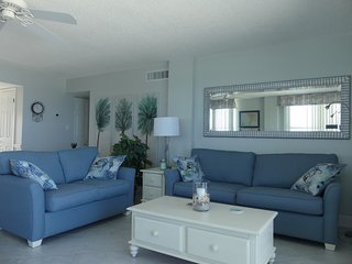 Living room with couch, loveseat, and 2 recliners.