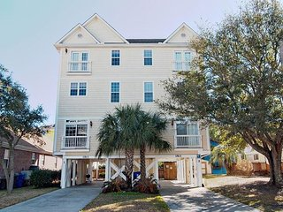 Come relax at an upscale duplex with pool nestled between mature live oaks