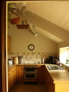 The well equiped Kitchen with views across the village green.