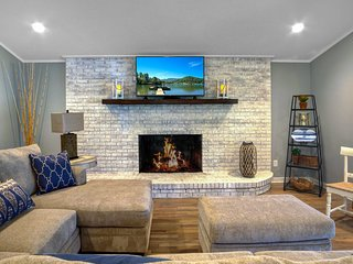 The upstairs living area is spacious that includes, WiFi, fireplace and a beautiful view of the lake