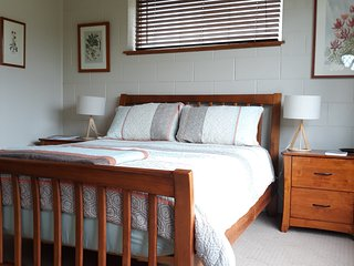 Queen bed, quality linen and electric blanket, and a picture window to the garden.