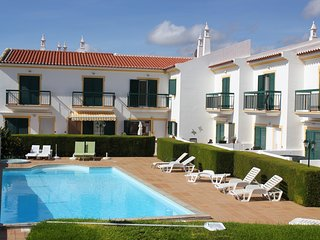 Modern 2 bed house with private patio and shared swimming pool.