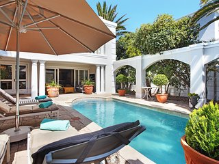 Maison du Cap is a luxury Villa set in a private garden and in Sunset Beach