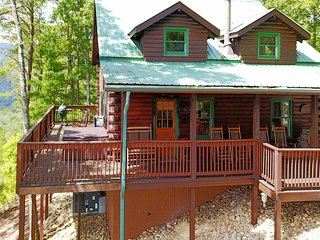 Charming family cabin with private hot tub, shared pool, & secluded location