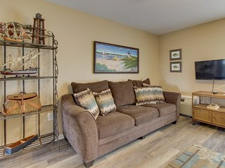 NEW LISTING! Comfortable condo w/ water views & shared pool - walk to the beach!