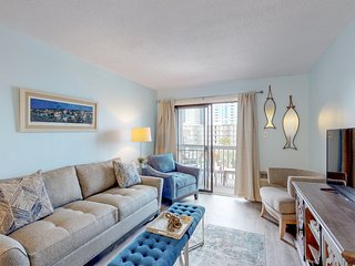 NEW LISTING! Lovely condo w/shared pool & balcony - one block to beach