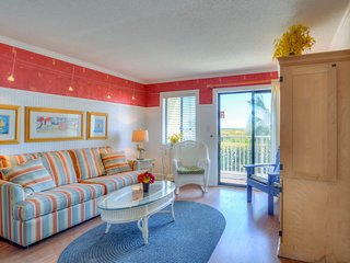 Roomy hotel suite near the beach and town features shared pool & hot tub!