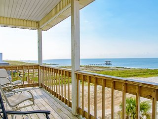 NEW LISTING! Charming beach-front home w/spacious wrap-around porch