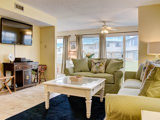 Condo offers boardwalk to beach, shared pool, common picnic area