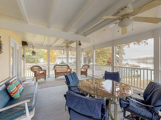 NEW LISTING! Lakefront home with dock, large covered porch, deck, outdoor shower
