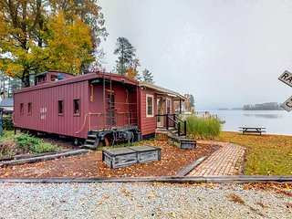 NEW LISTING! Renovated, unique caboose with a lakefront spot, pier, and dock!