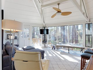 Dog-friendly condo with furnished patio near the beach - lots of windows!