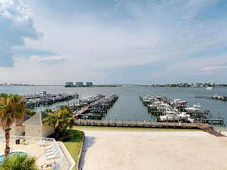 NEW LISTING! Waterfront condo w/ views, private balcony, & shared pool/hot tub