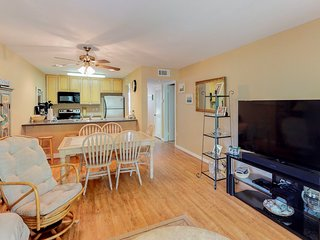 Second-floor condo with access to shared golf course, pool, and tennis courts