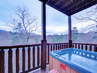 NEW LISTING! Mountain view cabin w/ private hot tub, game room, and shared pool!