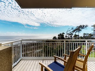 Right on the beach, with two shared pools, hot tub, & spectacular views