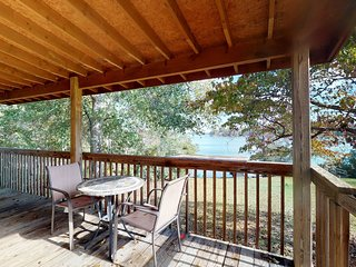 NEW LISTING! Charming lakefront cabin on two acres with dock &  firepit