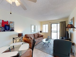 NEW LISTING! Cozy, waterfront condo w/shared pool, hot tub - walk to the beach