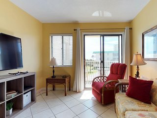 NEW LISTING! Condo by the beach w/ Gulf views plus shared pool & hot tub