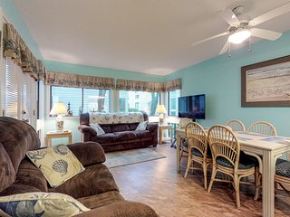 Colorful, welcoming condo with shared pools, hot tub & sauna 1 block from beach