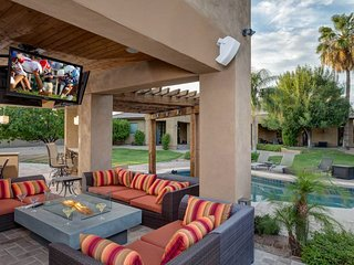 Luxurious living w/ a private pool, swim-up bar, outdoor kitchen, & more