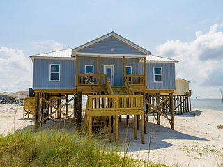 NEW LISTING! Beachside home with covered deck, full modern kitchen, & free WiFi