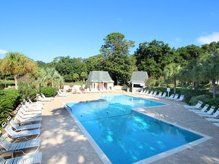 Dog-friendly townhouse w/ golf course views & shared pool - beach nearby!