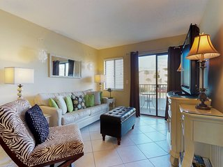 NEW LISTING! Colorful waterfront condo w/shared pool, hot tub, saunas-near beach