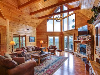 Dog-friendly luxury cabin with hot tub, game room, & wrap-around deck!