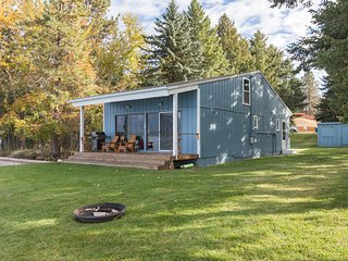 Waterfront cabin w/ a large yard, furnished deck, dock, & lake access