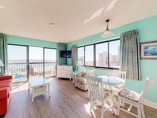 Snowbird friendly condo w/ ocean views & shared pool - steps from the beach!