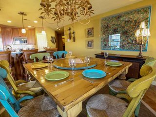 The gourmet kitchen and charming dining room are perfect for dinner parties!