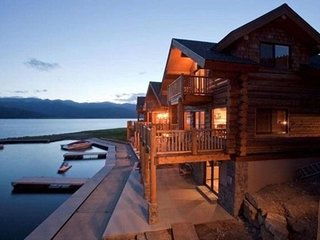 NEW LISTING! Spacious lake front home with hot tub, grill, and mtn/lake views!