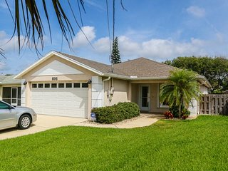 Contemporary dog-friendly home, w/fenced yard, & only one block from the beach!