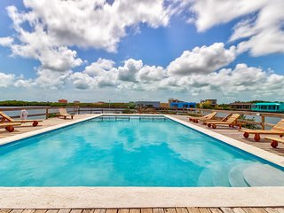 Oceanfront condo with shared pool, easy beach access, and great location!